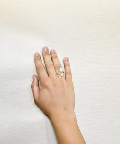 Hand with ring with unequal pearls in stainless steel