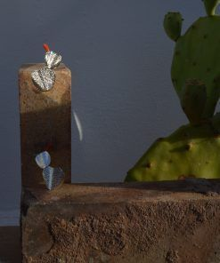 silver earrings still life