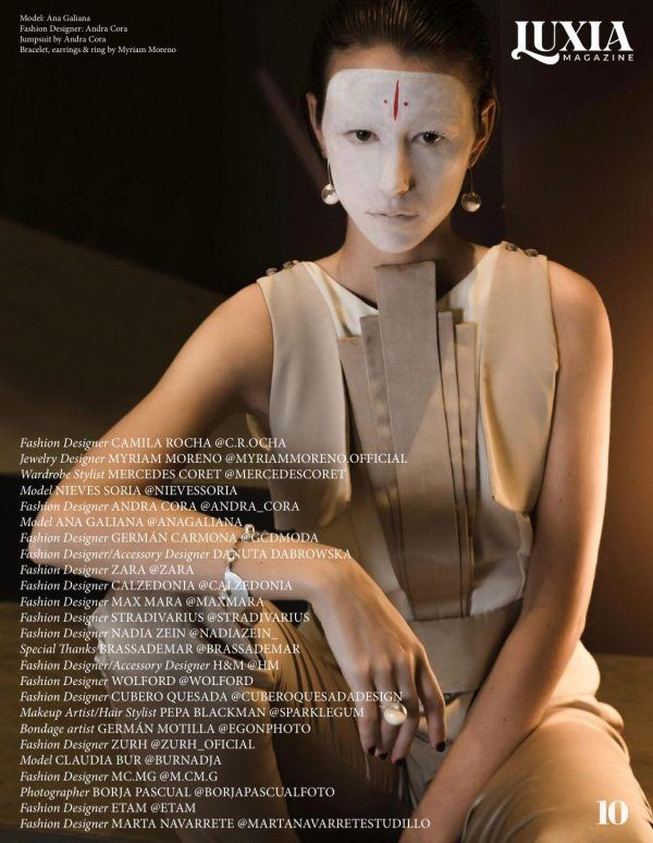 Luxia magazine page with bionic woman with japanesse makeup and sphere glass earrings